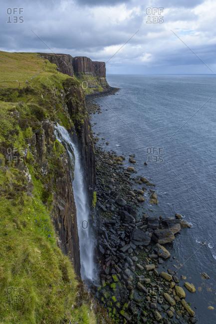 Mealt Waterfall with Kilt Rock on the Trotternish peninsula on the Isle of Skye in Scotland, United Kingdom