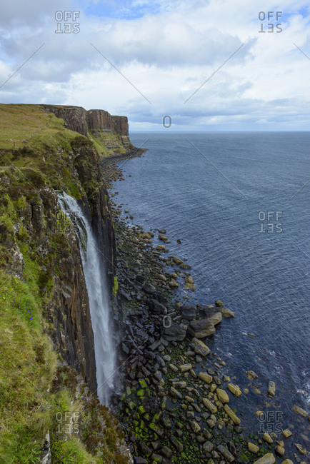 Mealt Waterfall with Kilt Rock on the Trotternish peninsula on the Isle of Skye in Scotland, United Kingdom