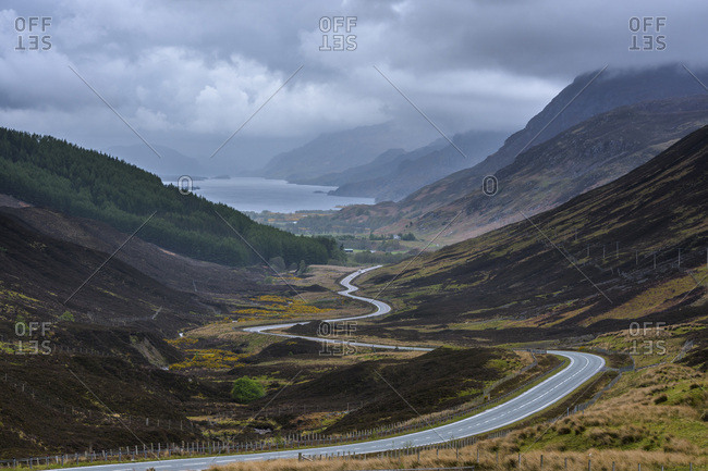 Winding highway through the typical Scottish countryside in the highlands of Scotland, United Kingdom