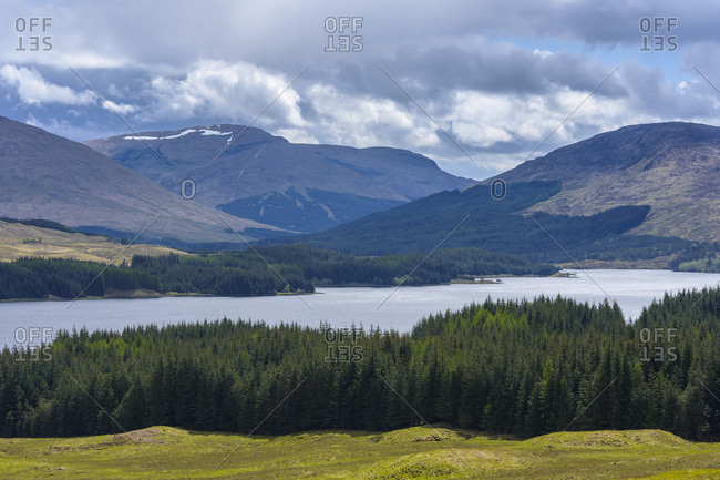 Scenic landscape of hills and a Scottish loch in springtime in Scotland, United Kingdom