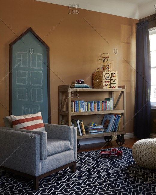 Los Angeles, CA - August 15, 2016: Playroom with a bookshelf and chalkboard
