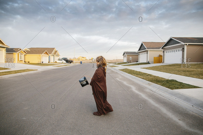 Boy wearing brown robe on Halloween