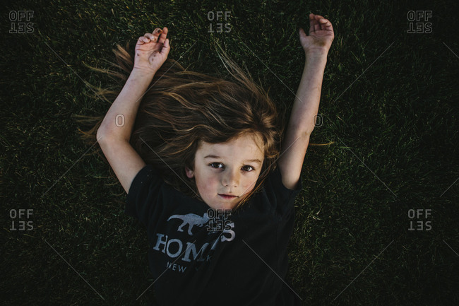 Portrait of blonde boy lying in the grass