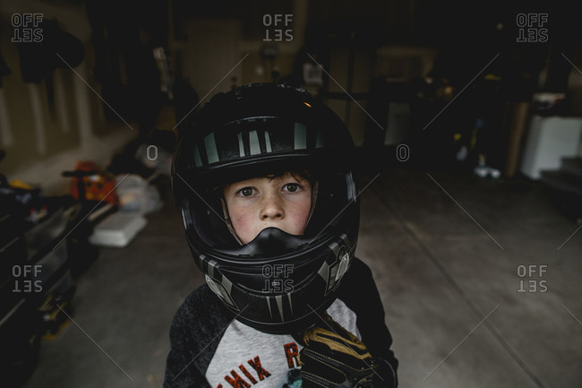 Boy wearing a motorcycle helmet