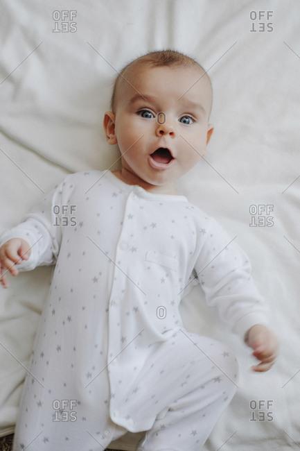 Portrait of astonished baby boy