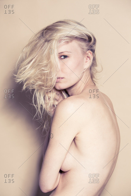 Nude portrait of blond young woman