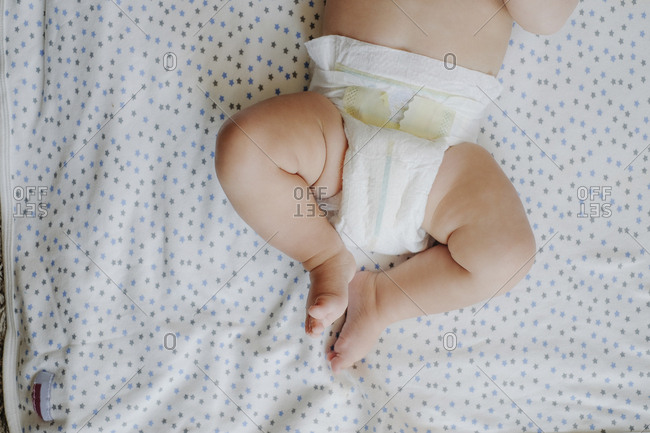 Baby boy wearing diapers- partial view