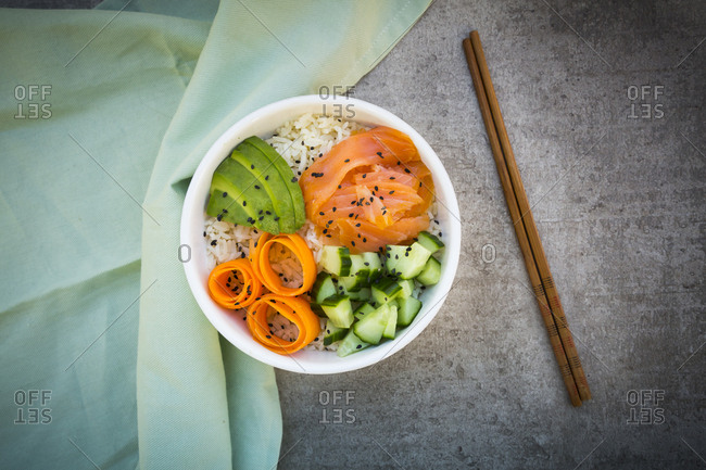 Sushi-Bowl with salmon- cucumber- avocado- rice and carrot