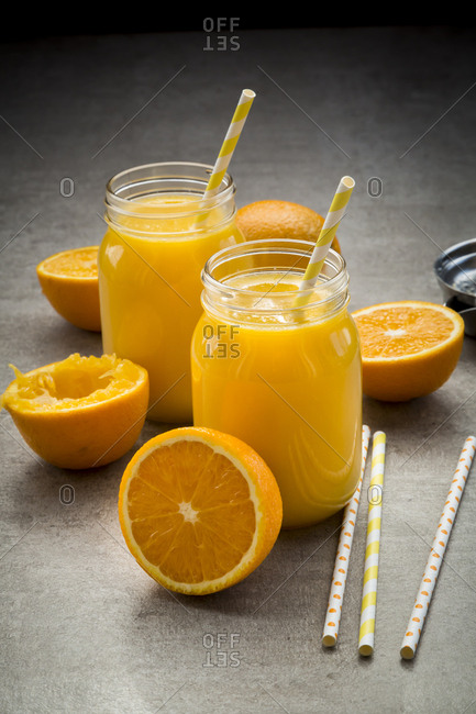 Oranges- glasses of freshly squeezed orange juice