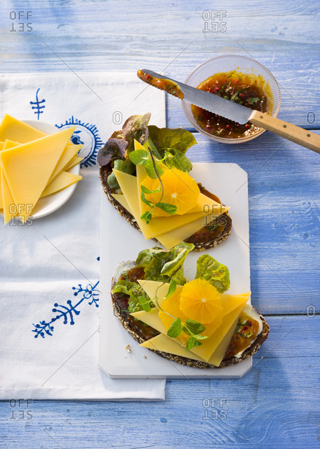 Sandwiches with sallow thorn chutney- cheese- lettuce leaves and orange slices