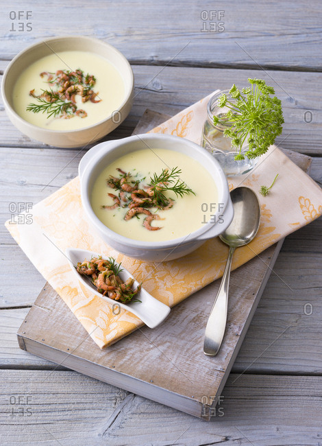 Cream of potato soup with North sea shrimps and dill