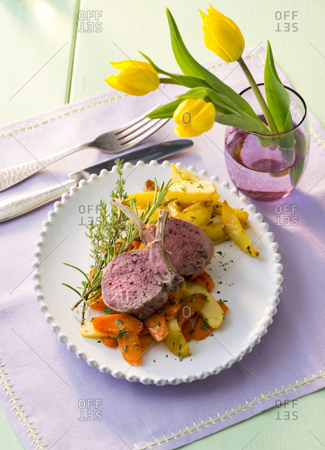 Lamb chop with vegetables on plate