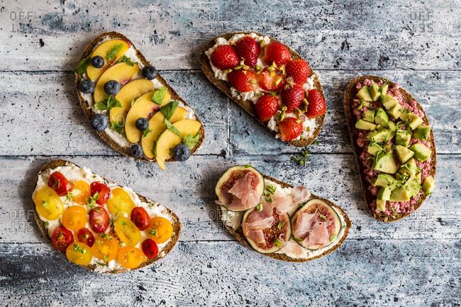 Different sandwiches- strawberry- fig- nectarine- avocado- tomato