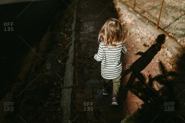 Child walking on pathway