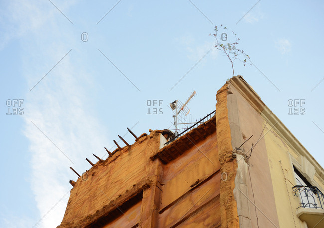 Antenna on rooftop of old building
