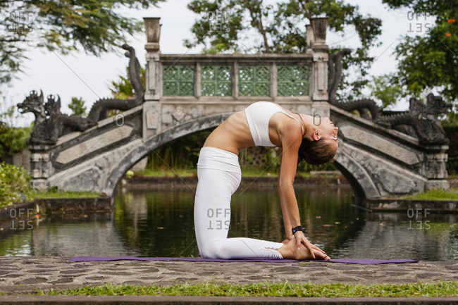 Woman practicing yoga in a park in Bali