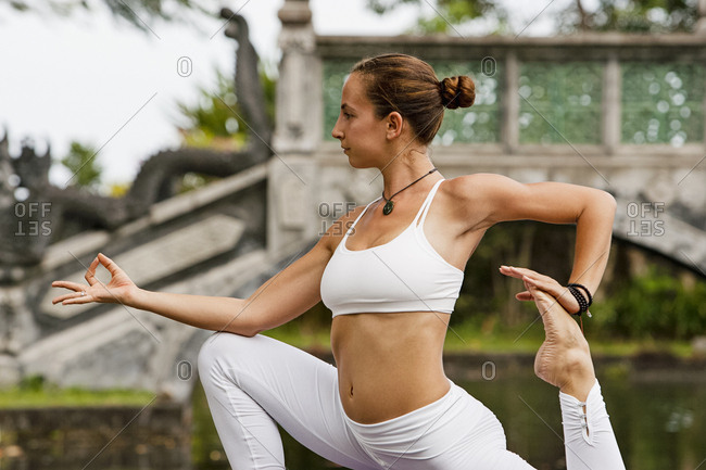 Woman in a yoga pose at a park in Bali
