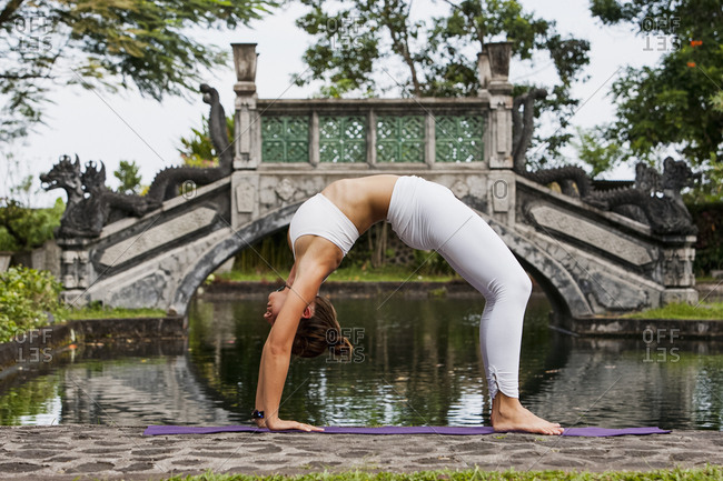 Young woman in a yoga pose at a park in Bali