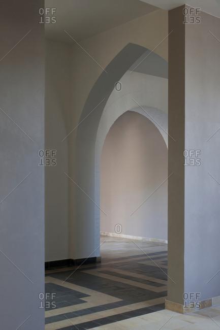 White archways inside a monastery