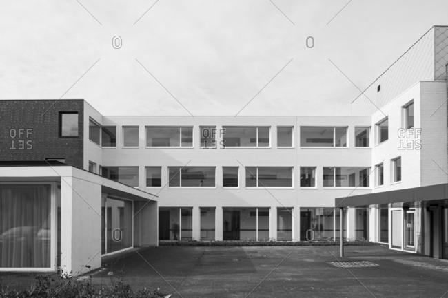 Eernegem, Belgium - March 7, 2014: Exterior of brick apartment building in black and white