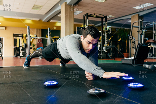 Man doing plank with lights exercise