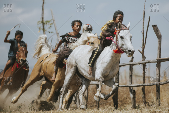 Indonesia, Sumbawa Besar - September 16, 2017: Jockeys riding racehorses during horse racing