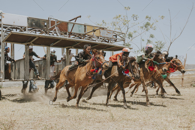 Indonesia, Sumbawa Besar - September 21, 2017: Jockeys riding racehorses during horse racing