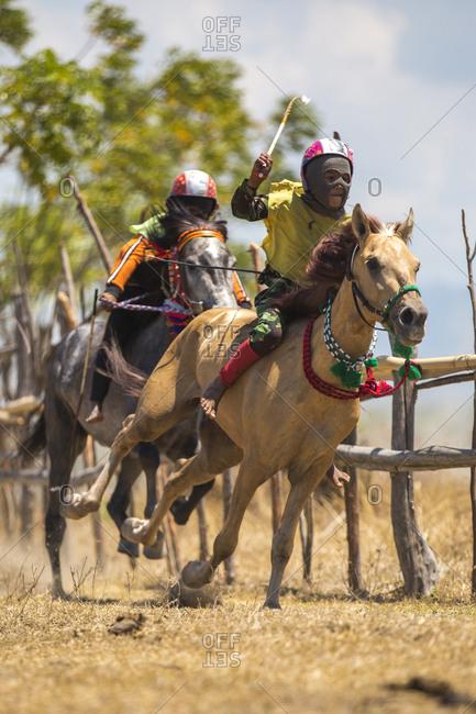 Indonesia, Sumbawa Besar - September 21, 2017: Child jockeys competing in traditional horse race