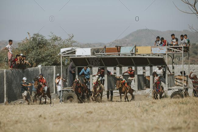 Indonesia, Sumbawa Besar - September 21, 2017: Jockeys competing in traditional horse racing