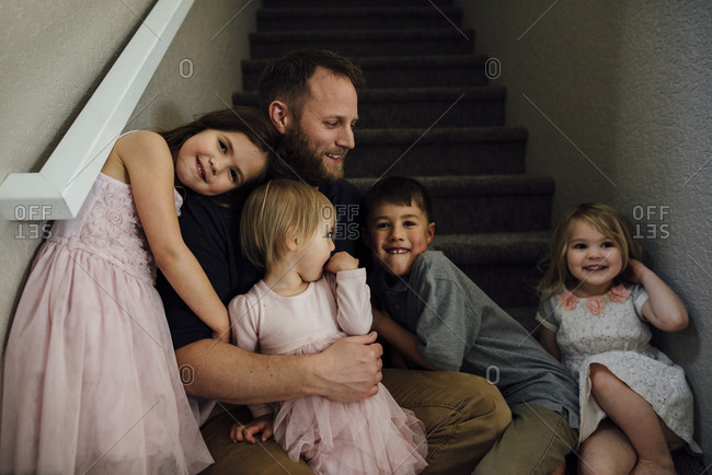 Cheerful family on steps at home