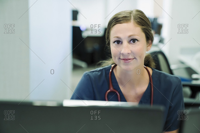 Portrait of confident female doctor in hospital