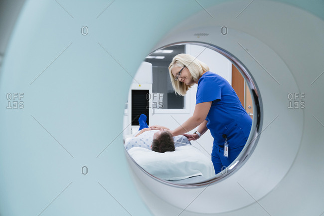 Nurse preparing patient for MRI Scan in hospital