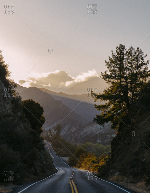 High angle view of country road by mountains against sky