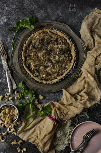 High angle view of mushroom tart and cashew nuts on table