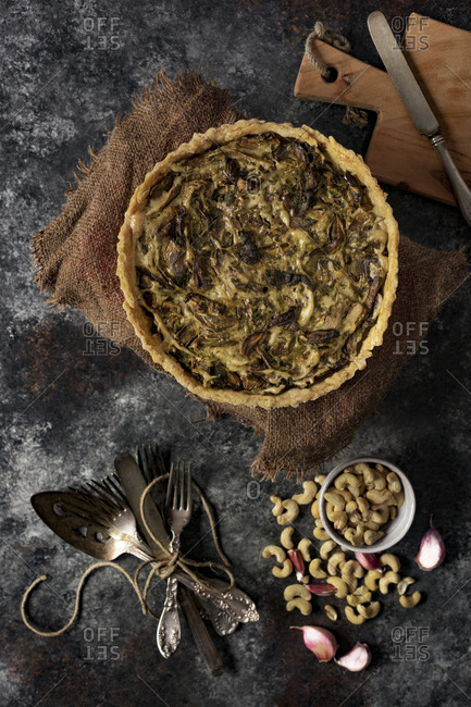High angle view of mushroom tart and cashew on table