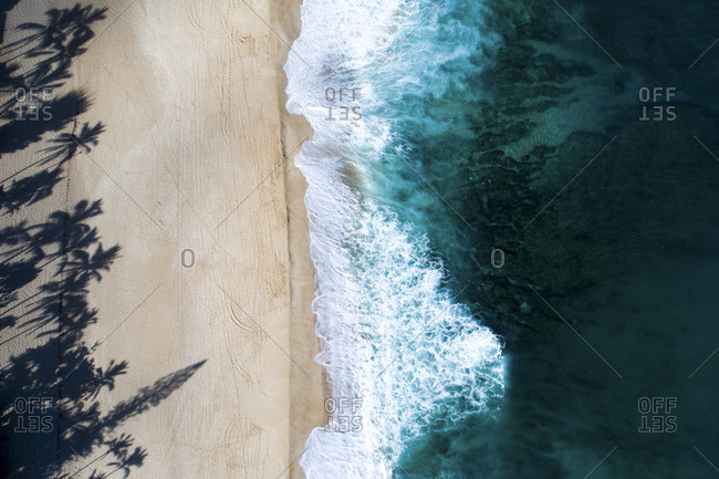 Tilt image of waves on shore at beach