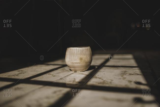 Sunlight falling on earthenware kept in darkroom