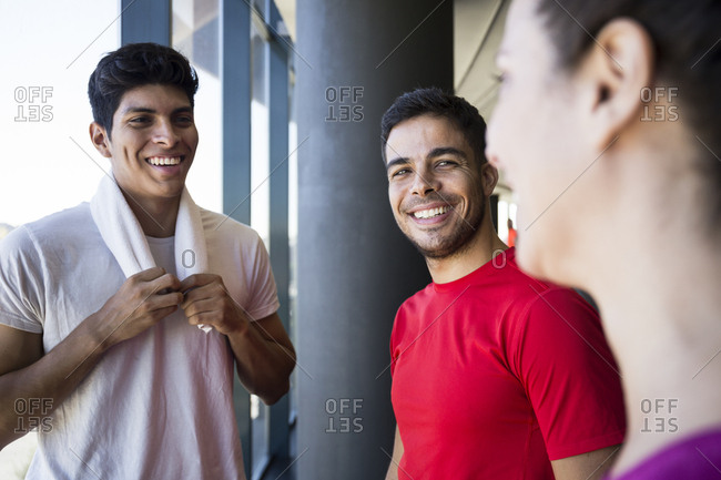 Smiling sportsmen having nice chat with each other during break