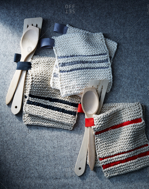 Knitted pot holders and wooden spoons