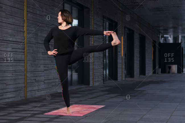 Woman doing yoga stretch on terrace