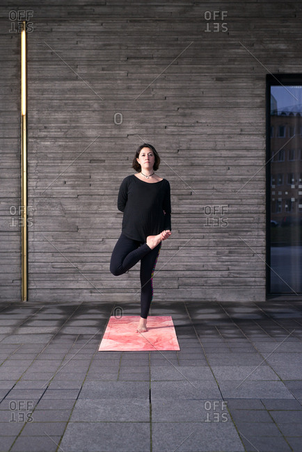 Woman stretching legs on a yoga mat