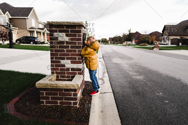 Boy reaching into mailbox
