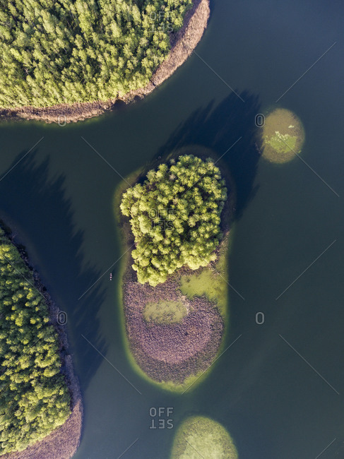 Tree covered islands in a lake in late spring