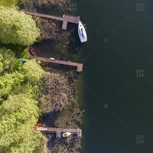 Docks along shoreline of lake with boats