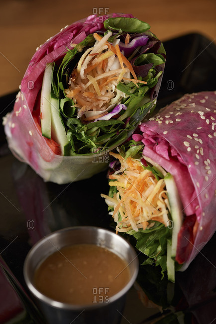 Wrap served in soft rice paper including spinach, carrots, basil leaves, cabbage and served with a sweet peanut sauce on the side