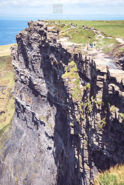 County Clare, Ireland - September 1, 2017: Massive cliffs of Moher on Atlantic ocean on sunny day, Ireland