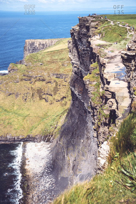 County Clare, Ireland - September 1, 2017: Massive cliffs of Moher on Atlantic ocean on sunny day, Ireland