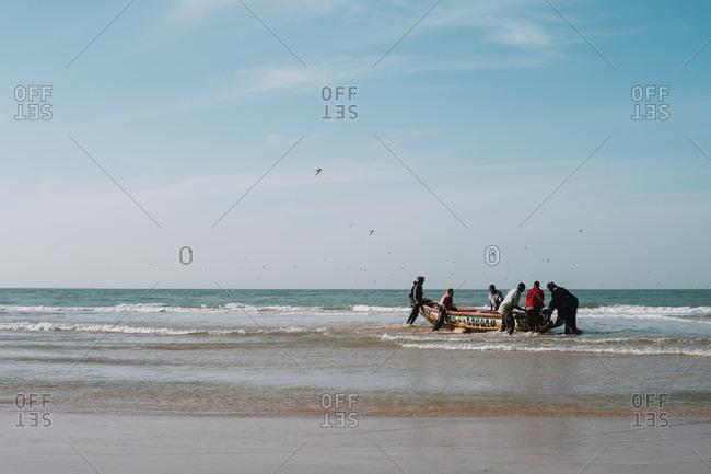 Yoff, Senegal - November 30, 2017: People on a boat