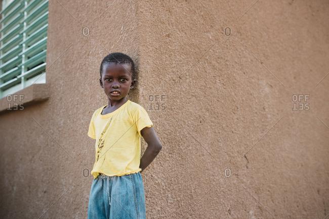 Dakar, Senegal - November 30, 2017: Portrait of little black boy at street
