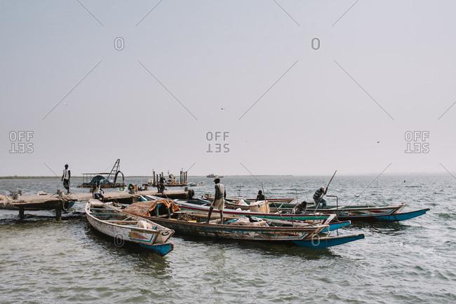 Dakar, Senegal - November 30, 2017: Riverbank with boats floating